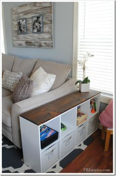 quick and easy kid storage great idea since we will need the room in the living room for the kids stuff