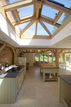 A beautiful oak orangery with a glazed lantern to bring natural light into the room.