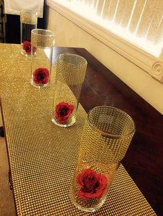 Set of 12 cylinder shaped vases for 78 dollars. Decorated