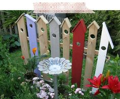 Birdhouse fence section - made for a children's garden - cute garden art, could set off birdfeeder, or act as trellis for very sparse vines (wouldn't want to cover it all up!) - doing each picket makes a strong birdhouse statement  ********************************************  FlamingPetal - #birdhouse #picket #fence - t√