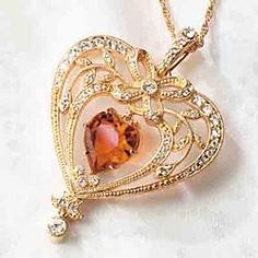 Victorian Topaz Crystal Heart Pendant...PLEASE BUY ME THIS, I WILL LOVE YOU. I love every single thing about this necklace, down to the gold, the bow, the heart, and the fact that it's MY birth stone!...jeez, I'm love.