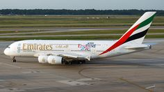 Emirates Airlines (AE) Airbus A380-861 A6-EET aircraft, with the sticker ''Rugby World Cup 2015 England 2015'' on the airframe, skating at USA Texas Houston George Bush Intercontinental Airport. 09/06/2015. (England Rugby World Cup 2015 18/09-31/10/2015).