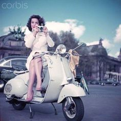 The Mexican actress, Maria Felix (1914-2002) posing in an advertisement for Vespa scooters