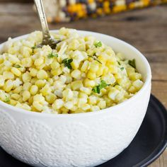 Creamy Parmesan Baked Corn - Blend of sweet corn, fresh Parmesan and a cream sauce made with half and half. Summer side dish or holiday favorite casserole.