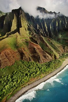 "Na Pali Coast, Kauai, Hawaii. Etched into a rocky canvas, the Na Pali (""The Cliffs"") coast on the island of Kauai is a living, breathing sculpture created by wind, rain, and time."