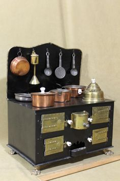 Visual inspiration for traditional cook stove ~ Antique Miniature Dollhouse Kitchen Tin Stove & Cookware  | Source: W Wolst @ Ebay