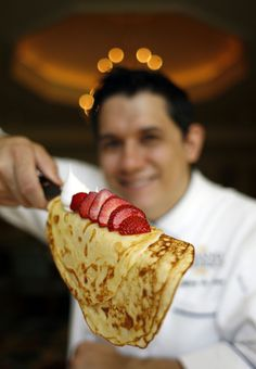 Jeffrey de Leon, executive pastry chef at the Grand America Hotel in Salt Lake City, knows how to make a tasty crepe and demonstrates how easy it is to assemble one of these French delicacies. The Grand America will be making hundreds of crepes for its Mother's Day holiday buffet. (Francisco Kjolseth  |  The Salt Lake Tribune)