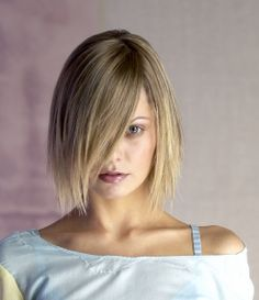 A medium blonde straight Womens haircut hairstyle by Dead Swanky