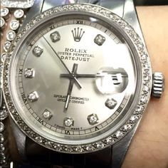 Rolex with Diamonds Rolex stainless with original parts except added white gold and over 1ct of diamonds. Comes with box and guaranteed authentic. No trades! Rolex Accessories Watches