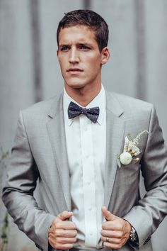 Dapper real groom in suit #graysuit #bowtie #groom
