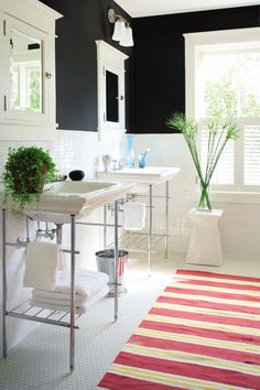 black walls, white tile in bathroom