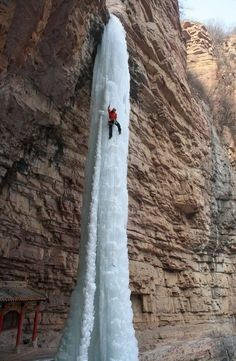 a frozen waterfall in China Climbing a frozen waterfall in China.Climbing a frozen waterfall in China. The Places Youll Go, Places To Visit, Les Cascades, Ice Climbing, Mountain Climbing, Mountain Biking, Pictures Of The Week, Adventure Is Out There, Wanderlust Travel