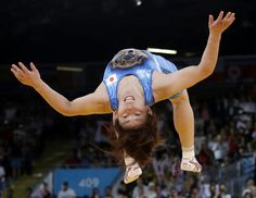 Saori Yoshida of Japan celebrates by doing a backflip after she beat Tonya Lynn Verbeek of Canada for the gold medal during their women's freestyle wrestling competition at the 2012 Summer Olympics, Thursday, Aug. in London. Olympic Wrestling, Olympic Games, Leg Injury, 2012 Summer Olympics, Olympic Athletes, Broken Leg, Winter Games, Sports Training