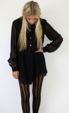 Striped black tights, long-sleeve black mini-dress