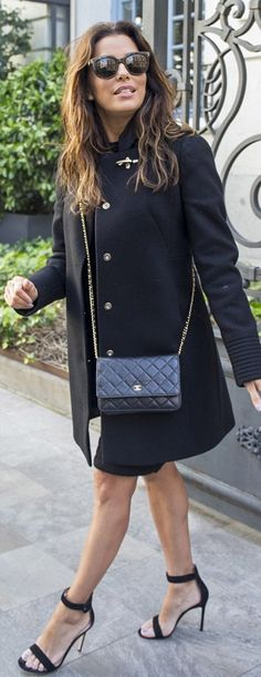 Eva Longoria's black coat, sunglasses, quilted handbag, and sandals