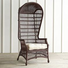 "Inspired by the 16th century French ""sentry,"" chair, our porter chair is hand-woven of all-weather wicker over a durable, rust-resistant metal frame. Originally designed to envelop and keep out the wind, our open-weave outdoor version coordinates perfectly with bright sunshine and fresh breezes.<span id=""mini-upsell"" data-launch=""true"" data-required=""false"" data-product=""Cushions"" data-masters=""PV200-23:1;PV285..."
