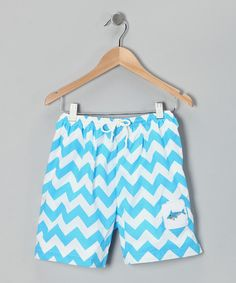 Any dapper dude will make a splash in vintage style sporting these lined swim trunks with an embroidered shark appliqué. A drawstring at the waistband ensures a comfy fit