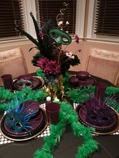Affordable Mardi gra table decor..thanks to  Dollar store and Hobby Lobby... $30 total ; )