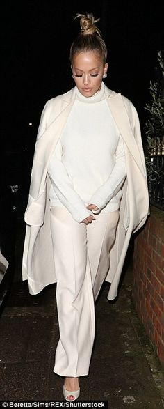 Rita Ora trades her VERY busty premiere dress for polo neck #dailymail