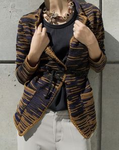 Erotokritos wool cardigan, necklace by CTNN