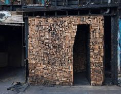 This room of carefully stacked wood wasn't built by creative urban beavers – it's an art installation made up of the outer timber of the surrounding crumbling house. The site is one of many houses in Detroit slated for demolition, but once this house is torn down, the wood sculpture will remain. Designed by Catie Newell and The Imagination Station, the project aims to revitalize the area with creative assemblages like this one.