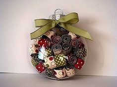 Rolled paper in clear glass ornament ball...love this!