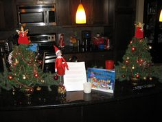 """December 9, 2014 ~ Sparky hanging out on our Island, and he came back with another note, and a book. """" Santa is Coming to Calgary!""""  (note below in comments...)"""