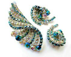 Vintage BEDAZZLING Teal Aurora Borealis Brooch Pin Earrings Set. $75.00, via Etsy.