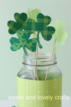 Paper shamrocks on sticks, my green vases, white candles and maybe some greens/flowers to finish it off
