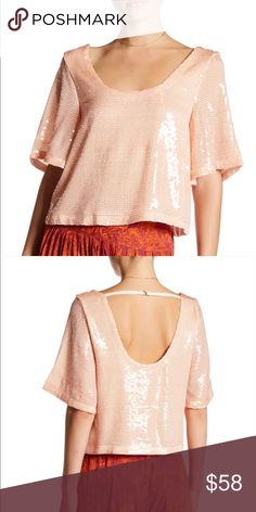 """Free People Night Fever Sequin Tee size XS & S New with tags!  Designed to elegantly drape around your frame, this slightly slouchy tee is cut with a generously Scoop neck and back and illuminated by scores of shimmering sequins. - Scoop neck - Elbow sleeves - Low back - Sequin detail throughout - Lined - Approx. 21"""" length (size M) - Imported Fiber Content 100% polyester Care Hand wash cold, line dry Additional Info Fit: this style fits true to size.  Measurements for size S. - Height…"""