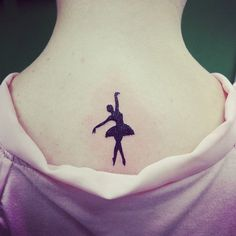 Small seductive tattoo on the back of my neck, tattoo is black because black is always in fashion.