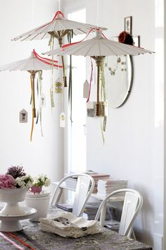 love these sweet hanging parasols