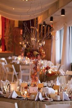 Fun fall wedding centerpiece (elegant tree branches with candles and orange flowers)