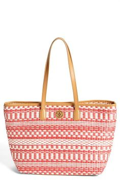 Great for the beach! Red straw tote by Tory Burch.