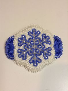 Fully beaded Snowflake hair barrette on moose hide made by Carmen Dennis