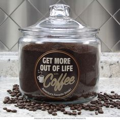 The Get More out of Life with Coffee Glass Jar is ideal for java junkies and caffeine addicts in your life. The perfect gift for any coffee lover, this kitchen canister sports a retro vinyl decal and glass lid. Holds 96 ounces. Jar measures 6.5