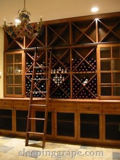 contemporary wine cellar by Rollin Fox, Sleeping Grape Wine Cellars with rolling library ladder Caves, Wine Furniture, Rolling Ladder, Home Wine Cellars, Wine Cellar Design, Library Ladder, Art Deco, Wine Wall, Wine Glass Holder
