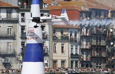 Mike Mangold of the United States, pilots his aircraft over the Douro river during the seventh stage of the annual Red Bull Air Race World Series in Porto, Portugal, Sunday, Sept. 7, 2008. - Boston.com