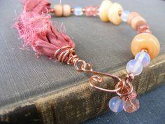 More Mermaid Glass lampwork alongside cherry quartz, rosewood, opal, copper and sari silk :)