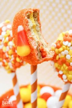 "Chocolate Covered ""Candy Corn Oreos"" On A Stick Drowned in Sprinkles. How simple is this!!"