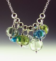 Marina-Hollow Lampwork Bead necklace 7 beads on 18 inch