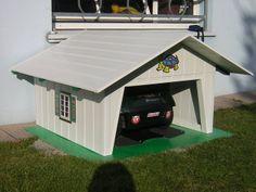 schicke m hroboter garage aus holz f r ihren rasenm her roboter vollst ndiger wetterschutz mit. Black Bedroom Furniture Sets. Home Design Ideas