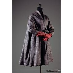 Vintage Fashion: An incredibly stylish, grey brocaded silk coat with wool plush lining. Designer: Madame Grès. Circa 1950. Photo Credit: The Museum at FIT