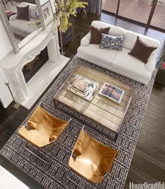 a life's design--furniture layout, but the rug is an eye catcher.  My next step is to buy a fireplace mantel and mount it on a board for an apartment.  Candles or fuel burners would work since it isn't a real fireplace.