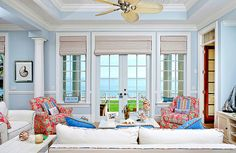 Cottage style living room- I like this fan. I would paint the walls a lighter color.