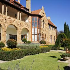 Northwards in Parktown, Johannesburg, has a stone facade and impressive arches. Johannesburg City, India House, African House, Cabins And Cottages, Africa Travel, South Africa, Beautiful Places, Mansions, House Styles