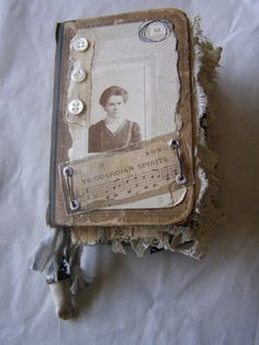 Nellie's Journals -- art journal -- guardian spirits-- buttons, washers, wire, lace, doll's hand, photo, and sheet music