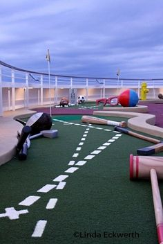 @Cindy Johnson Is that a baseball bat I spot ON a mini golf course ON a Disney cruise ship? They should have named the boat Cindy's Dream