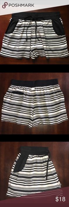 Kensie Striped Drawstring Shorts These like new Kensie shorts are a sure go-to for casual-comfy style. Size M. Black and cream striped pattern, and a drawstring waistband adorn these cute, lightweight shorts. Made of 100% rayon for a comfortable fit. Slanted front pockets and left back pocket. Metal logo tag at center back under waistband. These shorts are great for spring and summer. Kensie Shorts
