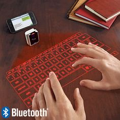 <b>Laser projection virtual keyboard transforms flat surfaces.</b><br /> Our virtual keyboard transforms a flat surface into an instant work station. So you can type up a storm any time you want. <br /> <ul><li>Type on any flat surface</li><li> Pair with Bluetooth phones, laptops, or tablets</li><li> Use with Apple and Android devices</li><li> Type for up to 2 hours per battery charge</ul>
